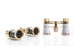 Two Pairs of opera glasses on a white background Stock Image