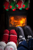 Two pairs of ornamented socks - Christmas family concept. Christmas concept - family in front of fireplace. Two pairs of ornamented Christmas socks Royalty Free Stock Photography