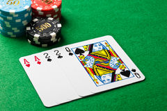 Two pairs in a poker game. With chips Royalty Free Stock Image