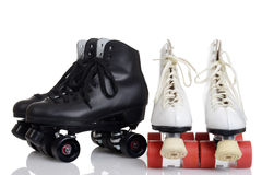 Two pairs quad roller skates Royalty Free Stock Images