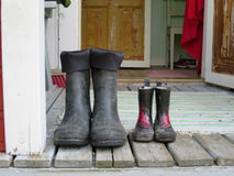 Two pairs of rubber boots. For father and child Royalty Free Stock Photography