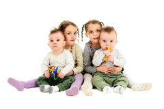 Two pairs, sets of twins - boys and girls. Having twins twice. Two pairs, sets of twin baby and twin children. Identical twin sisters are hugging identical twin Stock Photos