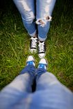 Two pairs of shoes on a green meadow Stock Images
