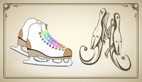 Two pairs of skates for artistic skating modern and retro. On a light brown background Stock Image