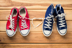 Two pairs of sneakers for men and women - the concept of love. stock images