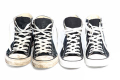 Two pairs of sneakers - one old, one new Stock Image