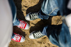Two pairs of sneakers. One red and one black Stock Photography