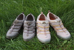 Two pairs of sports shoes In the grass Stock Photography