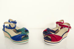 Two pairs of summer sandals. Red with blue and green with blue wedges. Stock Images