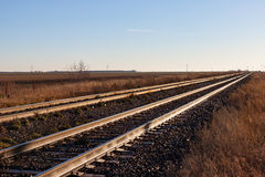 Two Pairs of Tracks Stretching Off to the Horizon Royalty Free Stock Images
