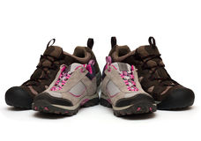 Two pairs of trekking shoes Stock Photos