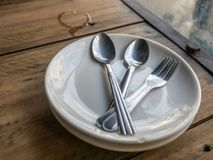 Two pairs of utensils on table Stock Photo
