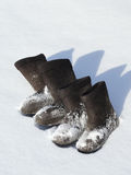 Two pairs of winter footwear Stock Photos