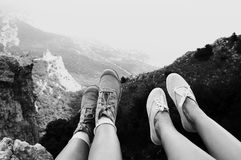 Woman feet over mountains Royalty Free Stock Image