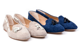 Two pairs of women suede shoes over white Stock Photos