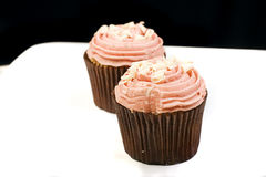 Two pale pink cupcakes Stock Photos