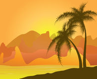 Two palm trees against mountains and sand Stock Photography