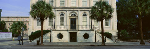 Two palms in front of historic home in Charleston, SC Stock Images