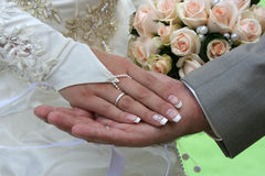 Two palms and wedding bouquet. Two palms together. It is man's and female palms Stock Images
