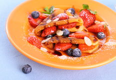 Two pancakes hearts, strawberry, blueberries almod Royalty Free Stock Photography