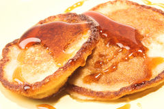 Two pancakes with maple syrup. Close-up of two pancakes with maple syrup Stock Photo