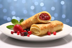 Two Pancakes with wild berries. Two Pancakes wiht wild berries on holiday background Stock Photos