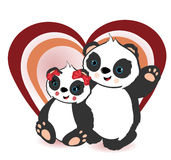 Two panda bears and a heart Royalty Free Stock Image