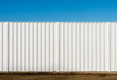 Two panels of a white metal fence. Used to screen off a building site stock image