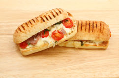 Two Pannini& x27;s on a wooden board Stock Photography