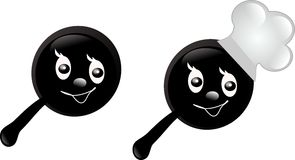 Two pans. Two black pans decorated with face and chef's hat Royalty Free Stock Photo