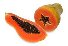Two papaya cut half. Papaya is a kind of fruit. When ripe will be yellow to orange. Simply cut the papaya in the half of the cavity. The soft juicy, sweet flesh stock photos
