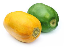 Two papayas. Green and ripe papayas over white background Stock Image