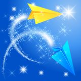 Two paper airplane and glowing stars Royalty Free Stock Photography
