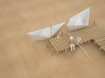 Two paper boats and fisherman. Are fishing on the pier. Origami scenery from recycled and packaging paper Stock Photography
