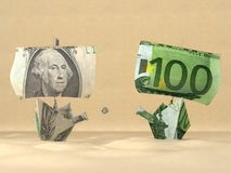 Two paper boats representing the dollar and the eu Stock Photo