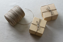 Two paper boxes and reel of thread Royalty Free Stock Photo