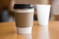 Two paper coffee cups Stock Photos