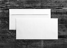 Two paper envelopes. Blank envelopes on wooden background. Two envelopes. Back and front view. Mock-up for your design. For design portfolios. Top view stock photography