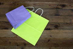 Two paper gift bags and wood background Stock Images