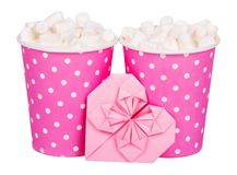 Two paper glasses with hot drink. Latte with marshmallow in pink glasses. Coffee and Valentine card. Isolated on white royalty free stock photography