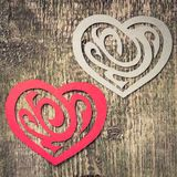 Two Paper Heart Ornamental Shape on wood Stock Photos