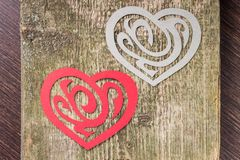 Two Paper Heart Ornamental Shape on wood Royalty Free Stock Photos