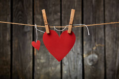 Two Paper Hearts Hang on Clothesline Royalty Free Stock Photography