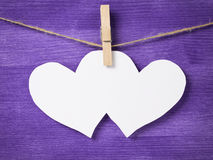 Two paper hearts hanging on rope Royalty Free Stock Photography