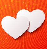 Two paper hearts over red background Stock Photos