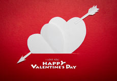 Two paper hearts pierced with an arrow symbol for Valentines day Royalty Free Stock Photo