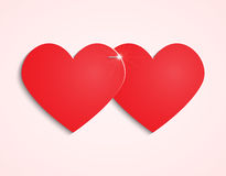 Two paper hearts stapling Royalty Free Stock Photos
