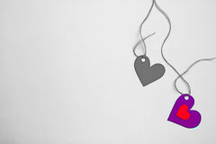Two paper hearts tide to a string on a desaturate background Royalty Free Stock Photos