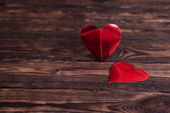 Two paper hearts on a wooden table royalty free stock photo