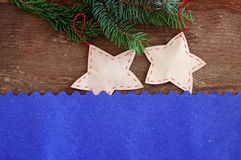 Two paper New Year's toys on an old wooden background Royalty Free Stock Photography
